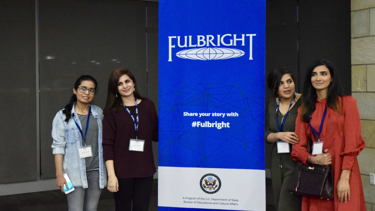 students pose with Fulbright banner