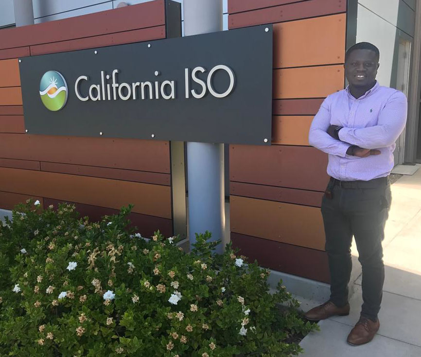 man standing in front of sign that says ISO