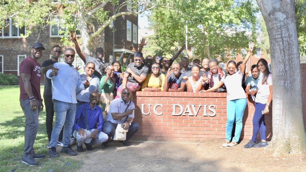 UC Davis Mandela Fellows with UC Davis sign on campus