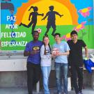 Picture of student team infront of outside mural
