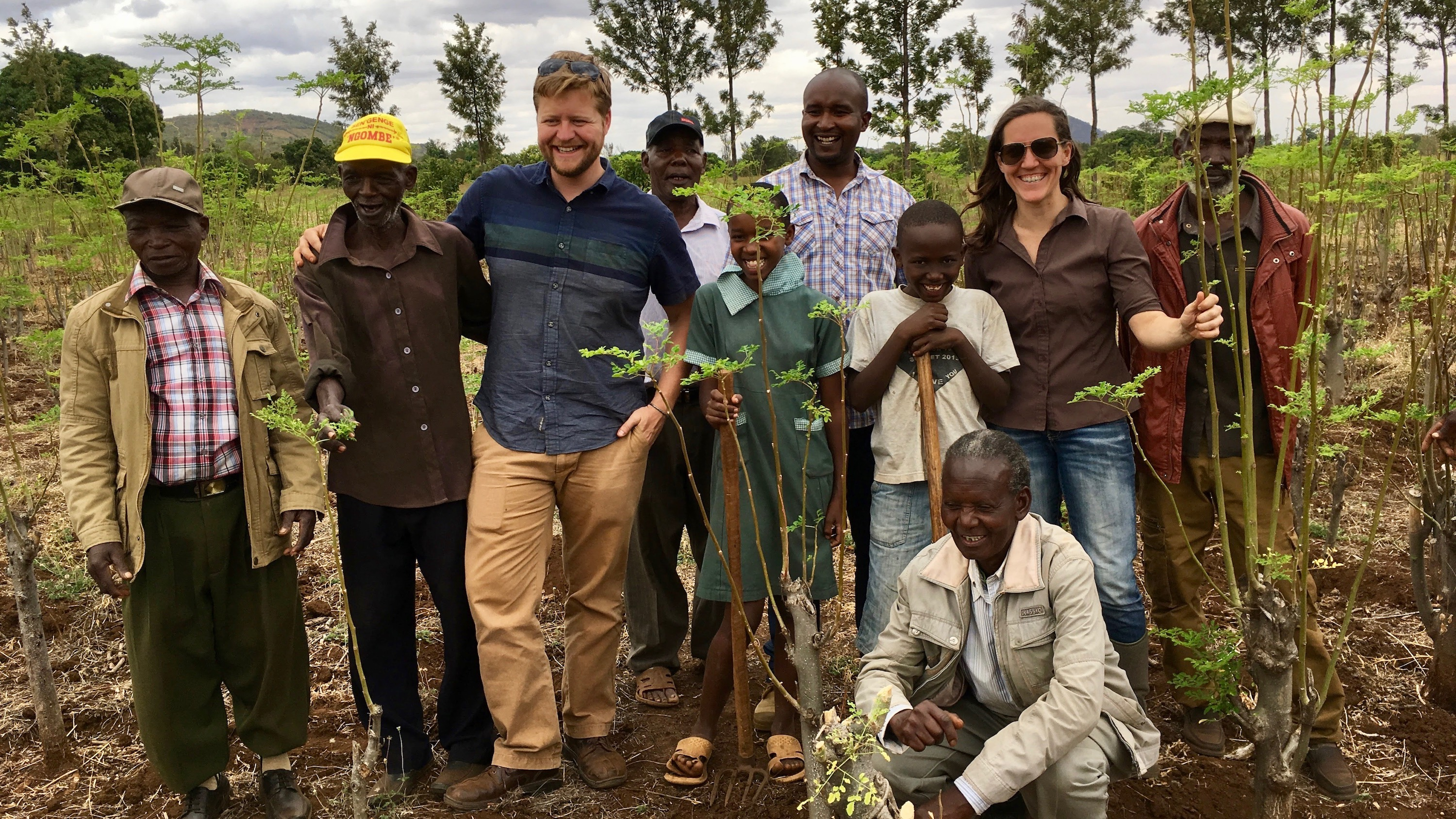Peterson (third from left) and Waterman (second from right) conduct inga cost/benefit analysis with moringa farmers in Meru, Kenya.
