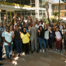 Chancellor Gary S. May and last summer's Mandela Fellows, outside the International Center.