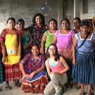 Graduate student Madeline Weeks and Karla Rueda McNeil of Cru Chocolate pose with members of the Red de Mujeres, a women's network in Guatemala