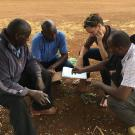 Waterman drafting construction plans for a moringa shade drying structures using local materials in Meru, Kenya.