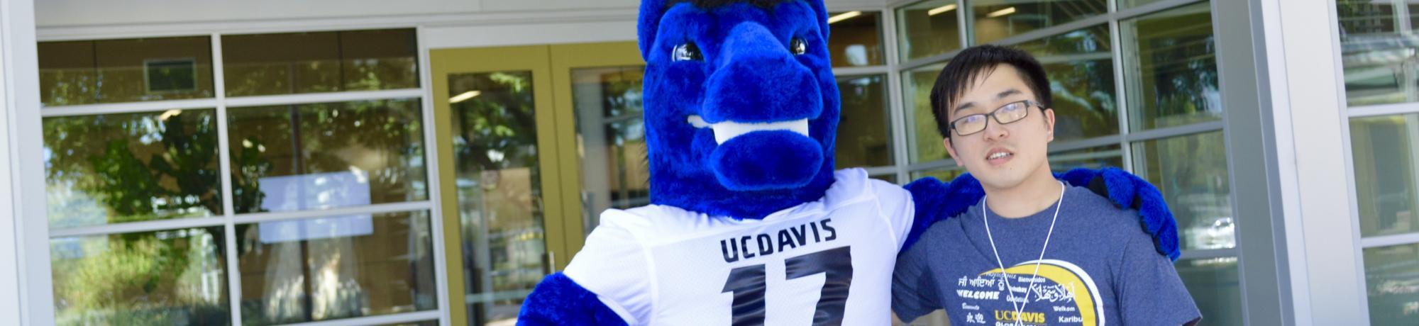 International student with UC Davis mascot