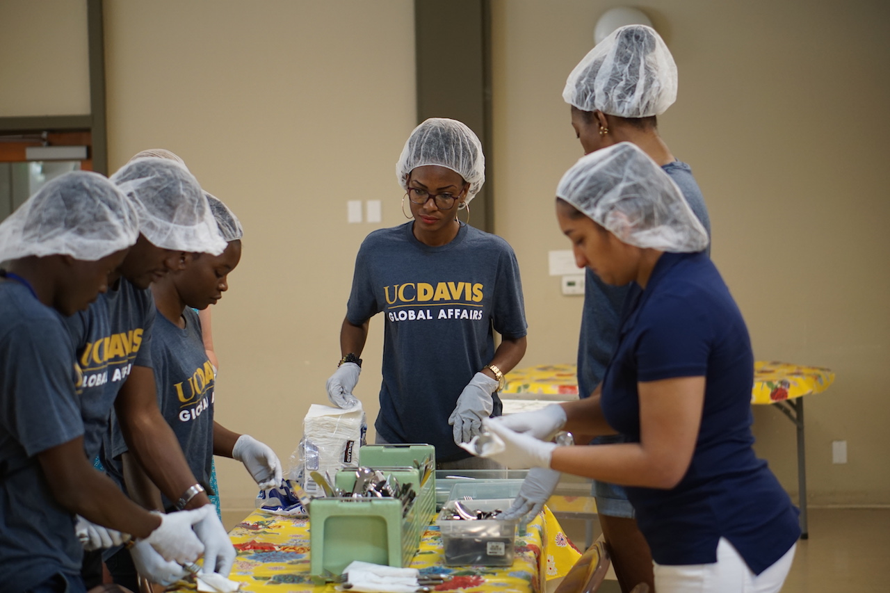 Wilsona Jalloh (center) volunteers with Davis Community Meals
