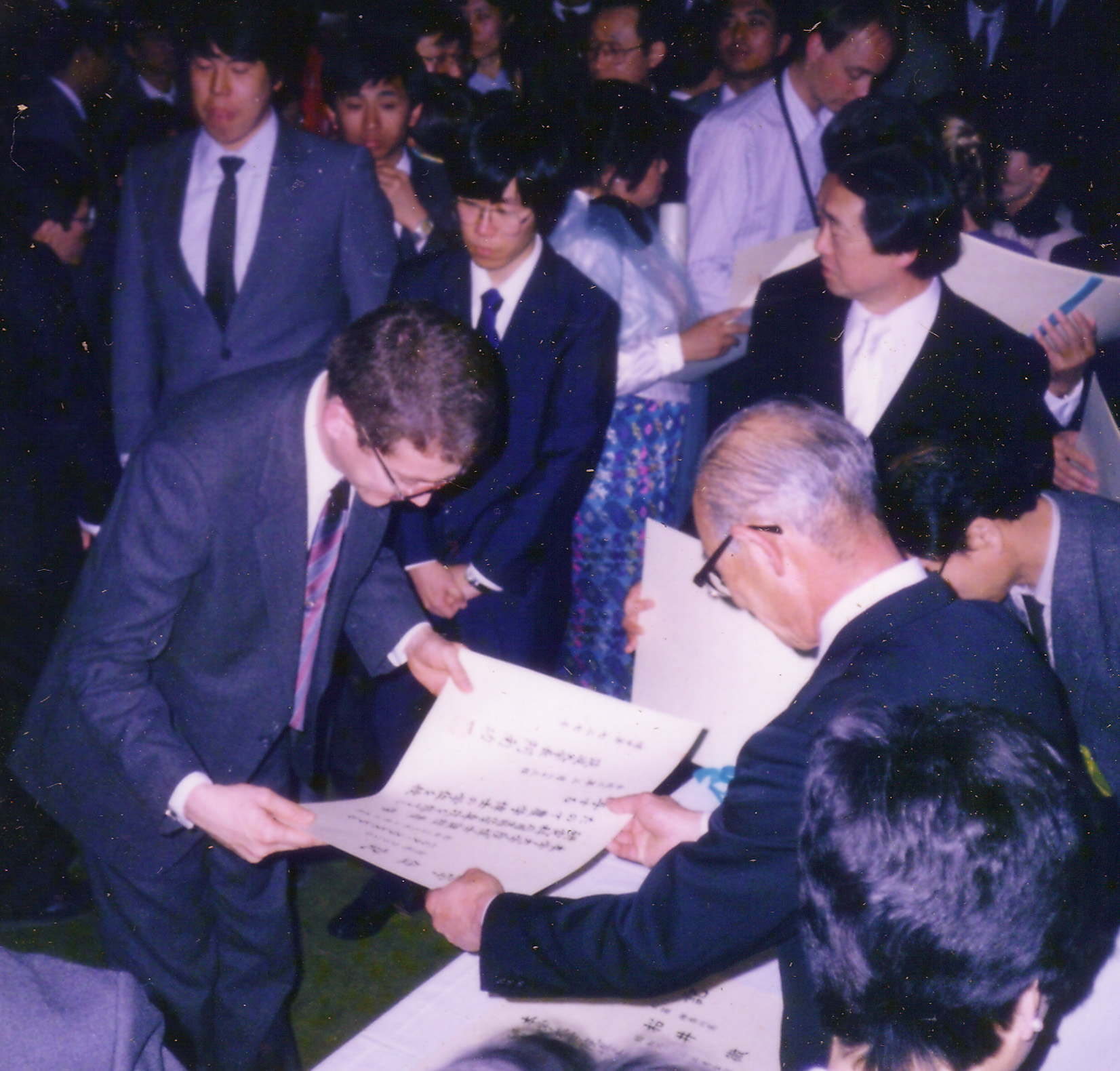 Leal receives his diploma in Japan