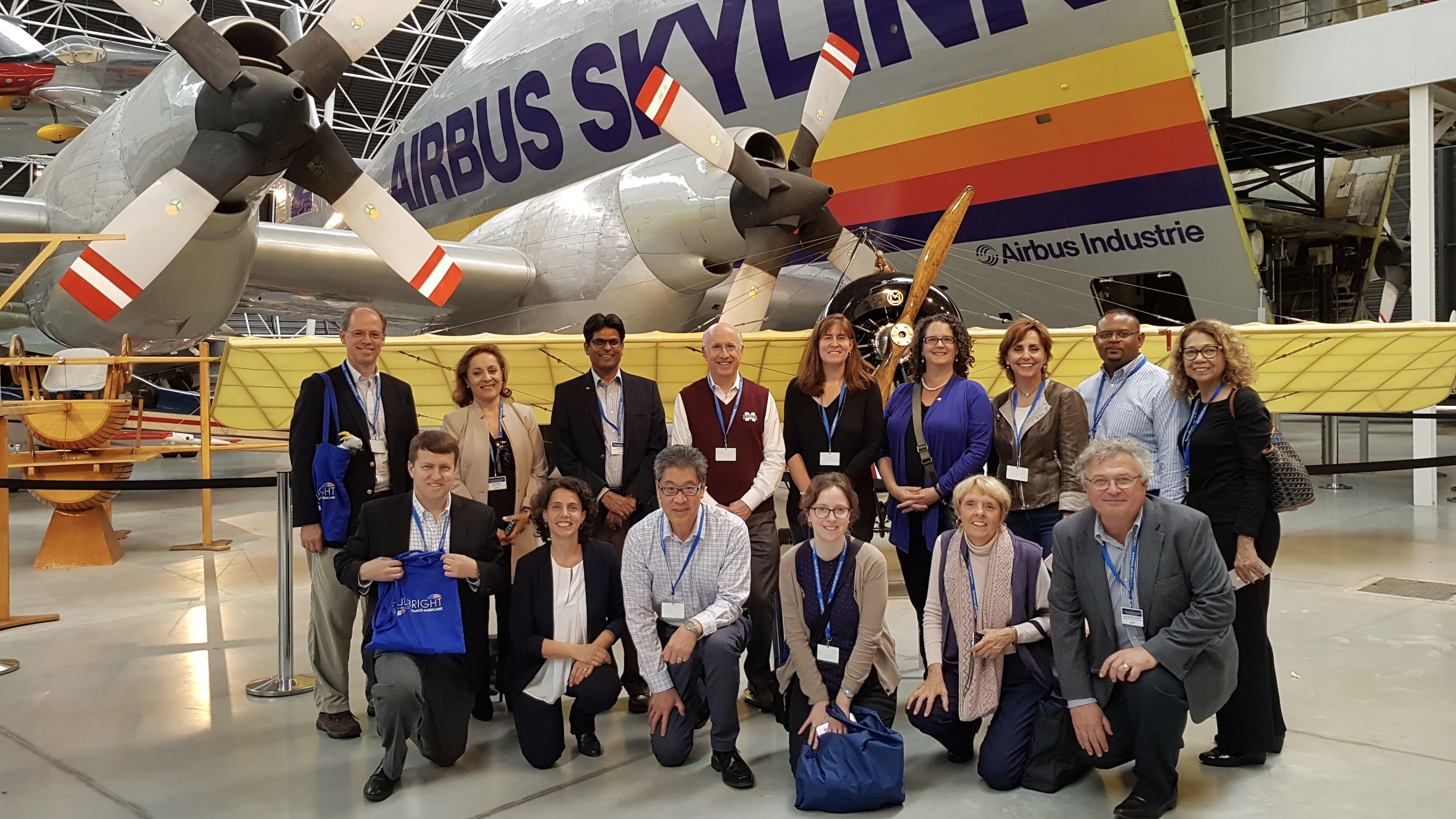 The Fulbright International Education Administrators (IEA) Seminar to France group (Director of Services for International Students and Scholars (SISS) Wesley Young third from left, kneeling) at the Airbus factory in Toulouse.