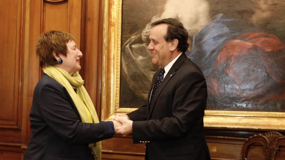 UC Davis Vice Provost and Associate Chancellor of Global Affairs Joanna Regulska shaking hands with Pontificia Universidad Católica de Chile Rector Ignacio Sánchez after signing an Agreement of Cooperation. Photo courtesy of Pontificia Universidad Católica de Chile.