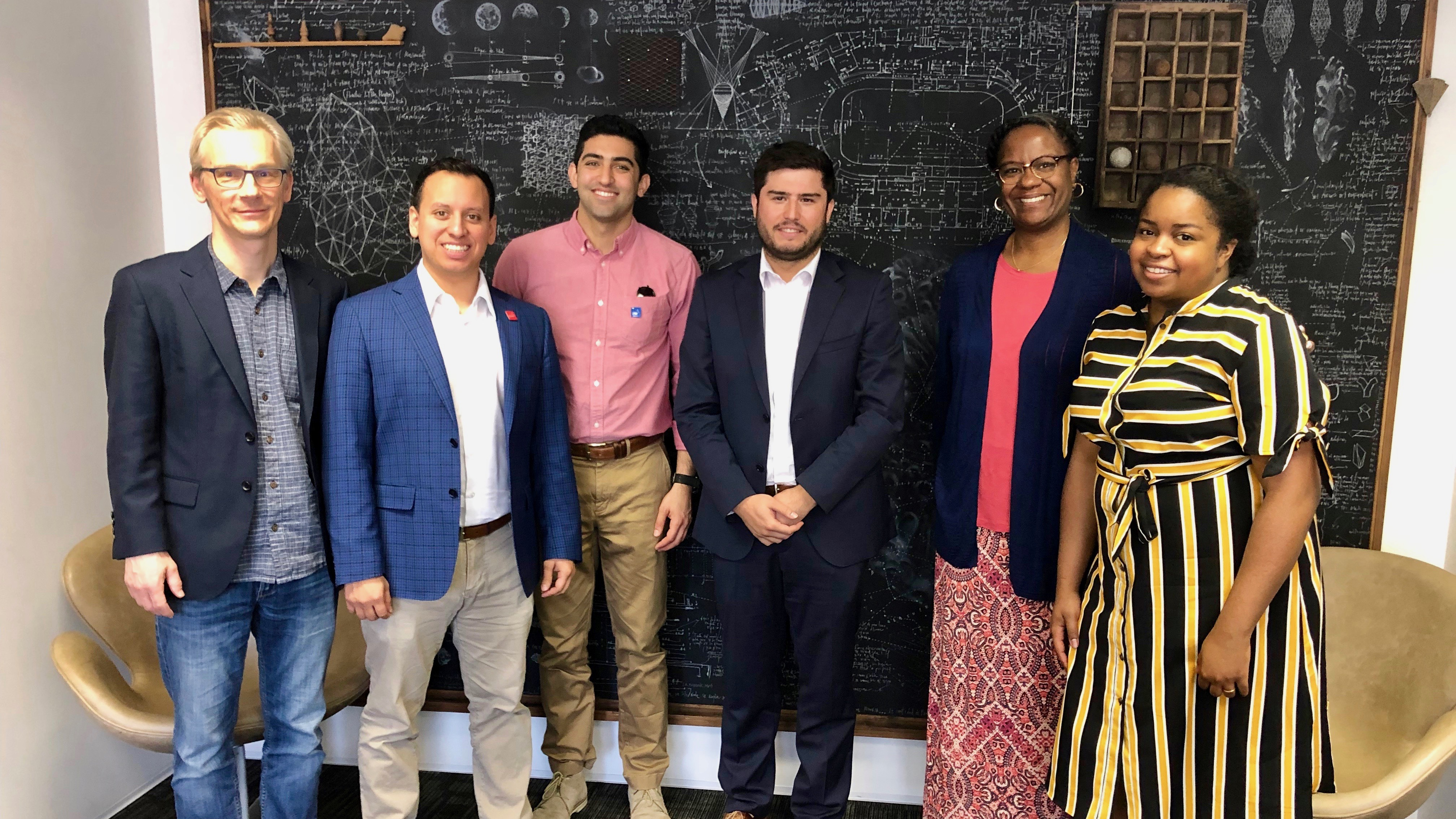 MBA students Stefan Bergman, Jesse Rodriguez, and Bryan Dastmalchi; CONICYT International Programs Coordinator Jack Brady; GSM Faculty Advisor Dr. Keisha Nichols; and GSM student Noelle Blanchard at CONICYT