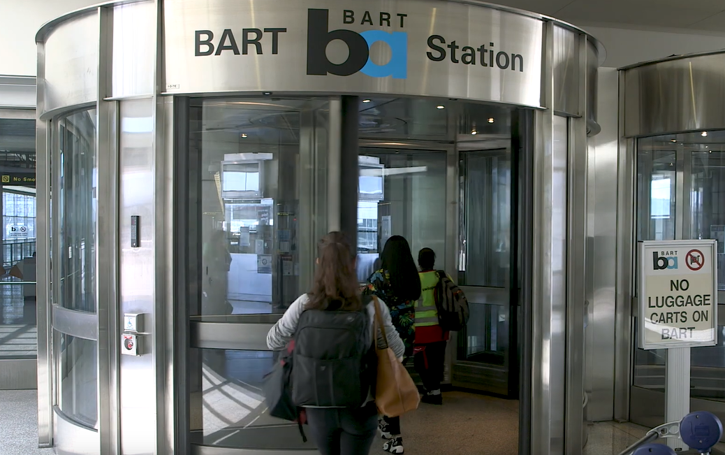 Sign at the airport terminal that reads 'BART'.
