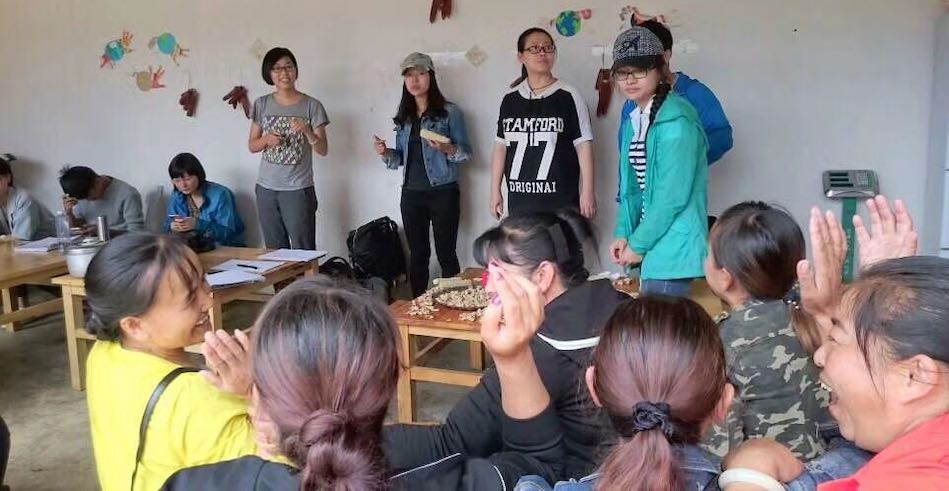 A group of farmers, consumers, and NGO practitioners investigating a CSA farm in a Bai village, southwest China. (Miaomiao Qi)