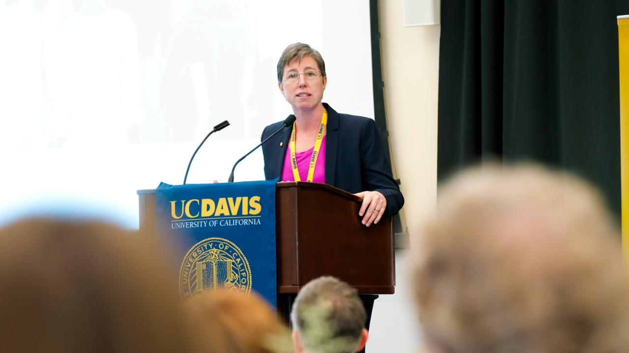 Mills College President Elizabeth L. Hillman at podium speaking