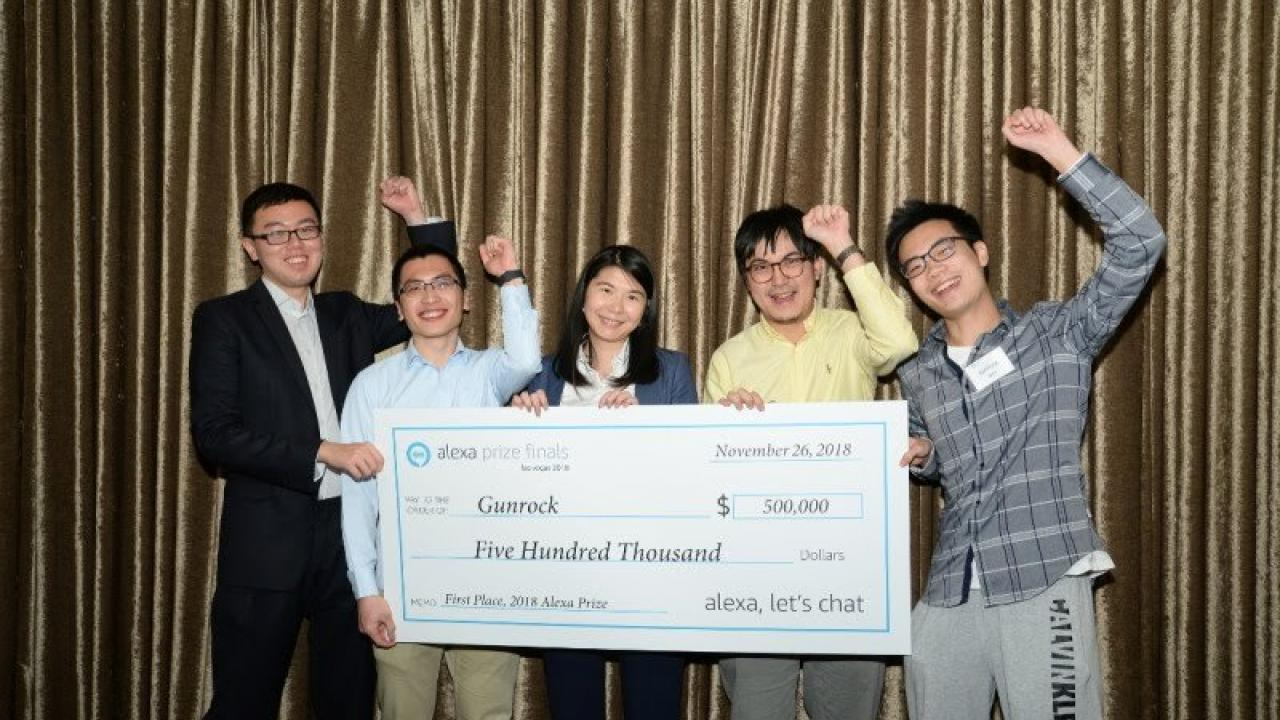 UC Davis graduate and undergraduate students celebrate their first place win in Amazon's Alexa Prize competition. Led by Assistant Professor Zhou Yu (center) UC Davis The team created a software bot that could hold a coherent and engaging conversation with humans.