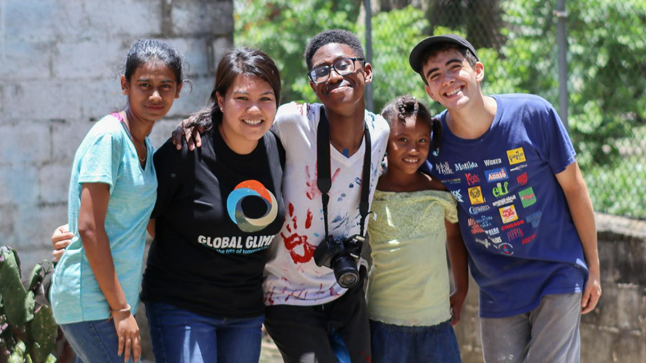 Felicia Ong '15, second from left, poses with New York high school students participating in her nonprofit program