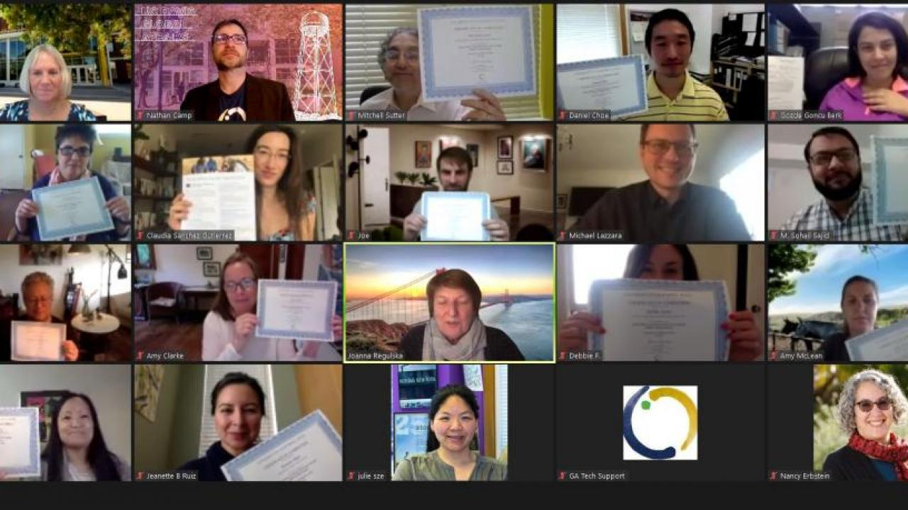 Faculty members who participated in the Curriculum Enhancement Through Global Learning program hold up their certificates of completion.