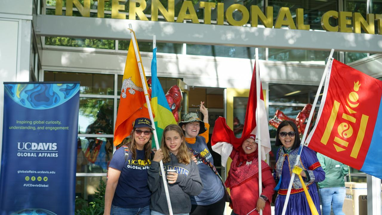 UC Davis Picnic Day parade participants holding international flags