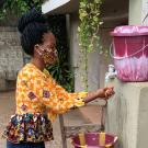 Wilsona Bumbenya at hand-washing station