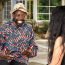 2018-19 UC Davis Humphrey Fellow Venance Segere from Tanzania  enjoying a discussion outside the UC Davis International Center.