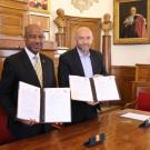 In a photo from @umontpellier on Twitter May 21, Chancellor Gary S. May and Philippe Augé hold up signed documents.